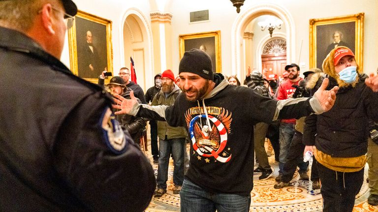 Supporters of President Donald Trump are confronted by Capitol Police officers outside the Senate Chamber at the Capitol