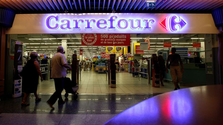 FILE PHOTO: Customers walk to enter in a Carrefour supermarket in Nice August 29, 2012