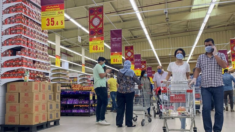 People wearing protective face masks push shopping trollies inside a Carrefour hypermarket, amid concerns over the coronavirus disease (COVID-19), in the Cairo suburb of Maadi, Egypt May 15, 2020