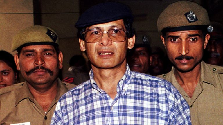 Indian policemen escort Charles Sobhraj as he leaves New Delhi's court room April 17 after an Indian court refused to immediately free him on bail, but said he may be granted bail at a later date. A French national currently in solitary confinement in India's maximum security New Delhi prison, Sobhraj once escaped prison in 1986 after feeding guards drugged sweets