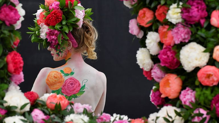 A model poses with body art and headwear made of Peonies at the RHS Chelsea Flower Show at the Royal Hospital Chelsea, London, Britain, May 20, 2019. REUTERS/Toby Melville