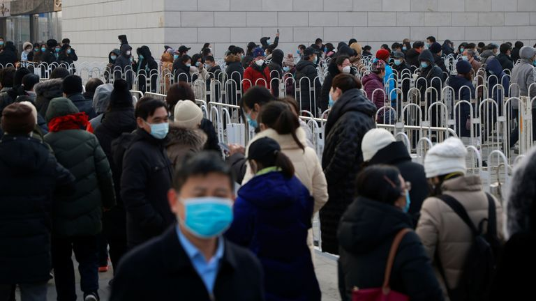 People queue to get tested after the latest COVID-19 outbreak in Beijing, China