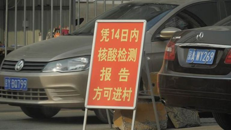A sign in Beijing telling people they cannot enter the area unless they have a negative COVID test