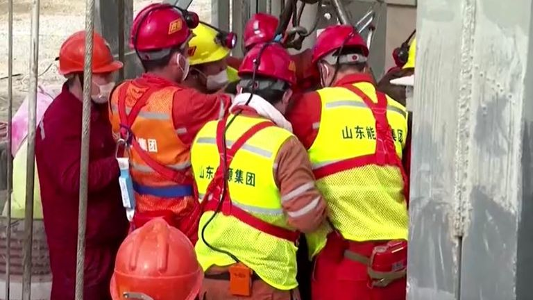 Miners are brought up from underground in China after being trapped for nearly a fortnight