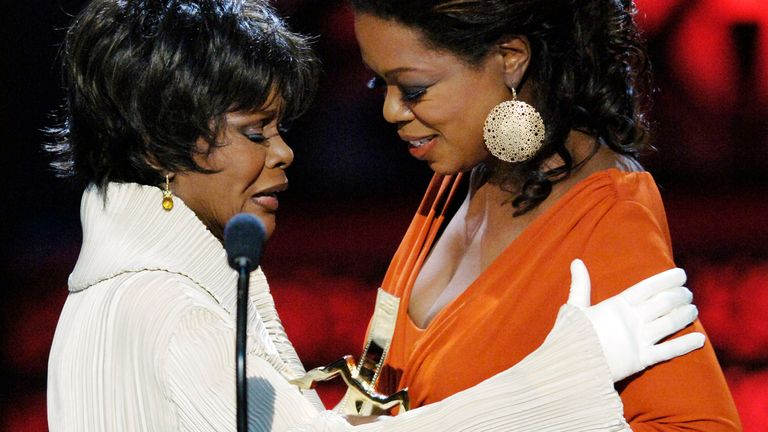 Oprah Winfrey (R) presents the Distinguished Career Achievement award to actress Cicely Tyson at the 2006 Black Movie Awards in Los Angeles