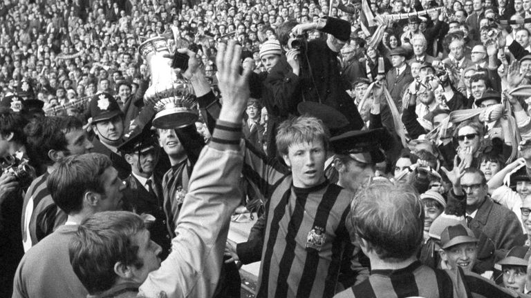 File photo dated 26-04-1969 of Manchester City's Colin Bell holds up the FA Cup with teammates in front of the Manchester City fans at Wembley Stadium after beating Leicester City 1-0..