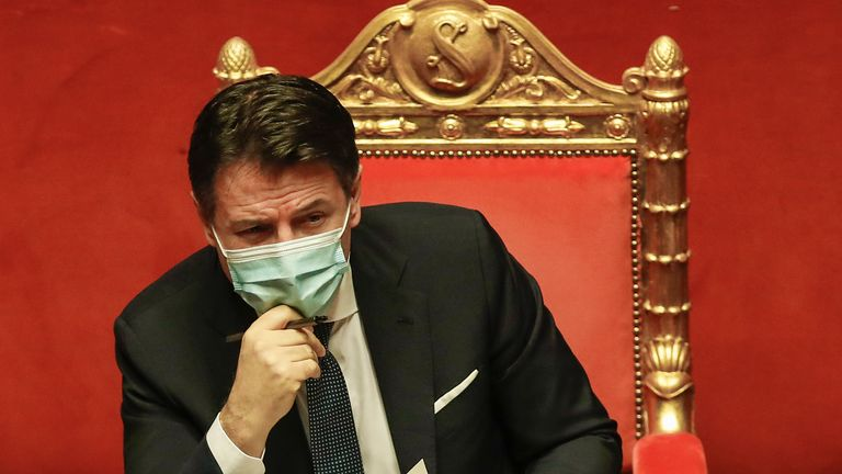 Premier Giuseppe Conte attends a debate at the Senate prior to a confidence vote, in Rome, Tuesday, Jan. 19, 2021. Conte fights for his political life with an address aimed at shoring up support for his government, which has come under fire from former Premier Matteo Renzi's tiny but key Italia Viva (Italy Alive) party over plans to relaunch the pandemic-ravaged economy. (AP Photo/Alessandra Tarantino, pool)