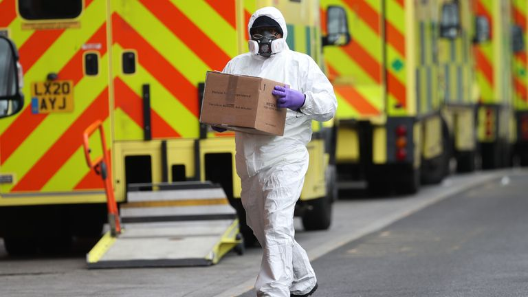 A man wearing PPE makes a delivery to the Royal London Hospital during England's third national lockdown to curb the spread of coronavirus. Picture date: Tuesday January 19, 2021.