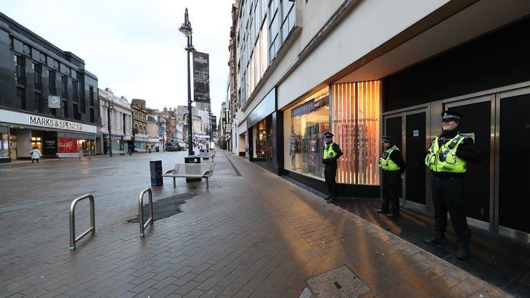 Police Community Support Officers (PCSOs) patrol along Briggate in the city centre of Leeds, Yorkshire, the morning after Prime Minister Boris Johnson set out further measures as part of a lockdown in England in a bid to halt the spread of coronavirus.