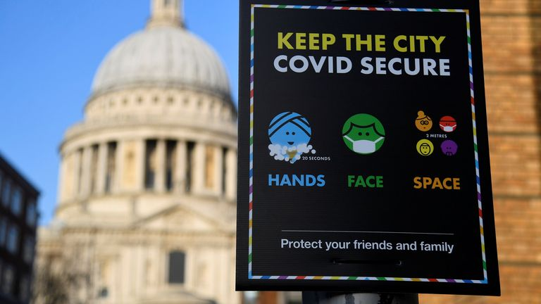 A public health information sign is seen with St. Paul's Cathedral seen behind amidst a lockdown during the spread of the coronavirus disease (COVID-19) pandemic, London, Britain, January 7, 2021. REUTERS/Toby Melville