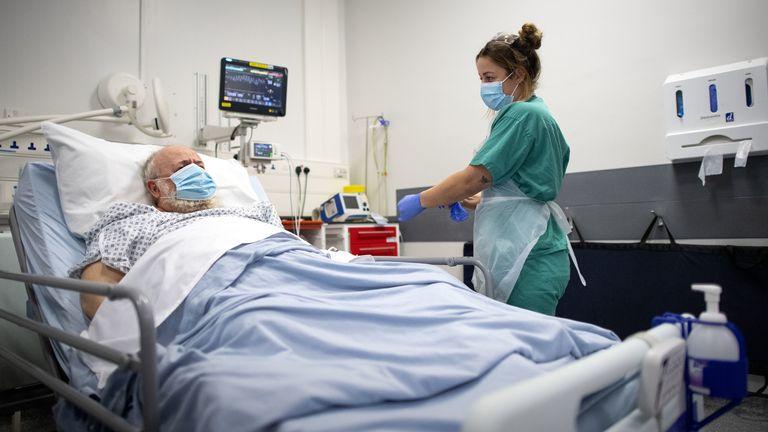 A staff nurse treats patient Peter Watts, 64, at St George's Hospital