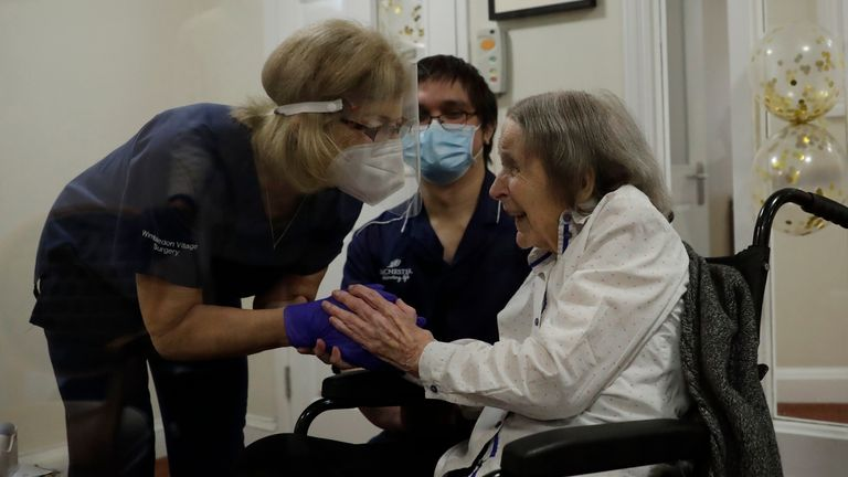Care home resident Joan Potts, aged 102, has received a first dose of a COVID vaccine. Pic: AP