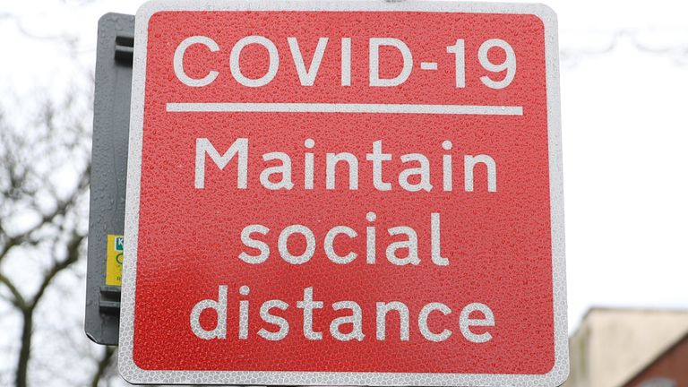 A Covid-19 social distancing sign on Commercial road in Portsmouth during England's third national lockdown to curb the spread of coronavirus.
