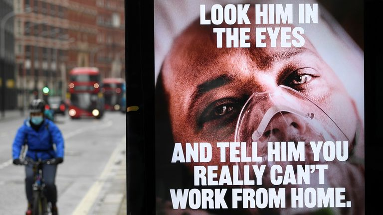 A British government public health information sign is seen on bus shelter amid the spread of the coronavirus disease (COVID-19), London, Britain, January 27, 2021. REUTERS/Toby Melville
