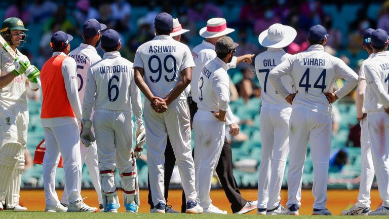 Indian players talk to the umpires