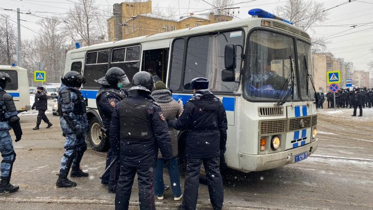 Police escorted detainees onto buses