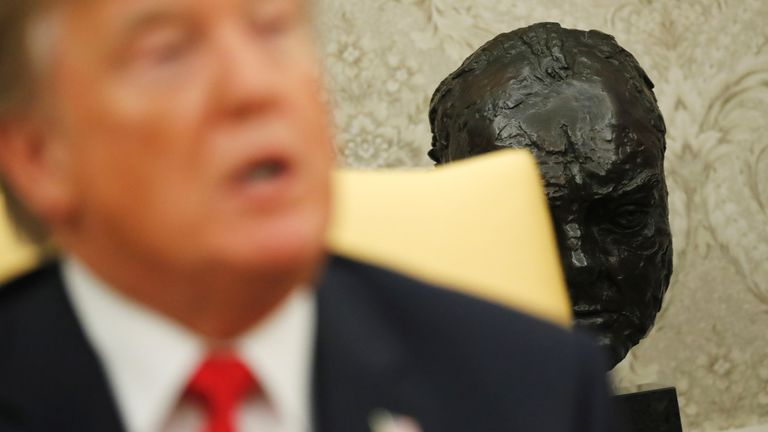 A bust of Winston Churchill sits behind U.S. President Donald Trump as he delivers remarks welcoming Canada's Prime Minister Justin Trudeau (not pictured) at the White House in Washington, U.S., October 11, 2017. REUTERS/Jonathan Ernst