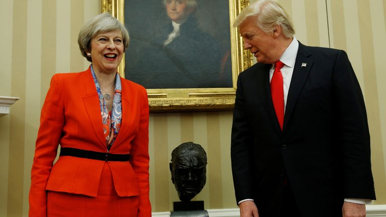 U.S. President Trump looks at Churchill bust while meeting with British Prime Minister May at the White House in Washington