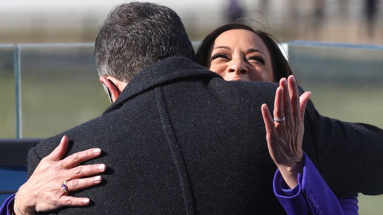 Kamala Harris hugs her husband Doug Emhoff after being sworn in as vice president. Pic: AP