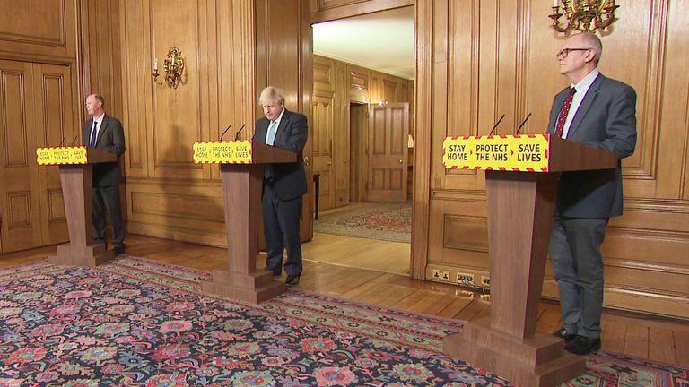 Boris Johnson and his scientific advisors speak in Downing Street.