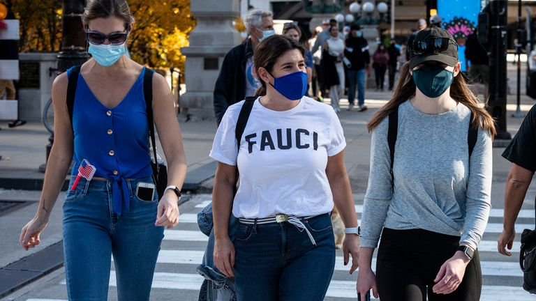A pedestrian wears a t-shirt bearing the name of Dr. Anthony Fauci after the election of Joe Biden as the 46th President of the United States on Saturday November 7, 2020 in Chicago, IL. (Photo by Christopher Dilts / Sipa USA)