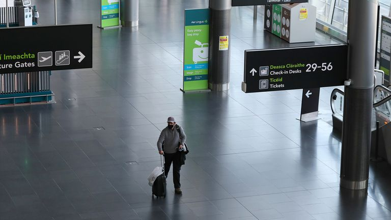 A man in a face mask at Dublin Airport