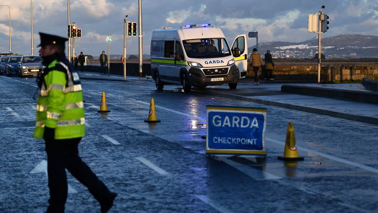 Police monitor a 5km travel limit at a checkpoint in Dublin