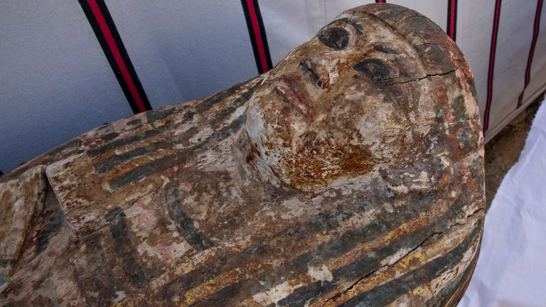 An ancient coffin is on display that Egyptian archaeologist Zahi Hawass and his team unearthed in a vast necropolis filled with burial shafts, coffins and mummies dating back to the New Kingdom 3000 BC, Monday, Jan. 17, 2021, in Saqqara, south of Cairo, Egypt. (AP Photo/Nariman El-Mofty)