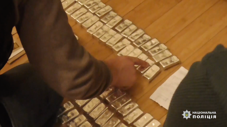 Gold bars were seized from suspects' properties. Pic: National Police of Ukraine