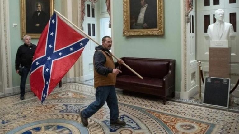 This man was seen carrying a confederate flag by the Senate chamber's entrance