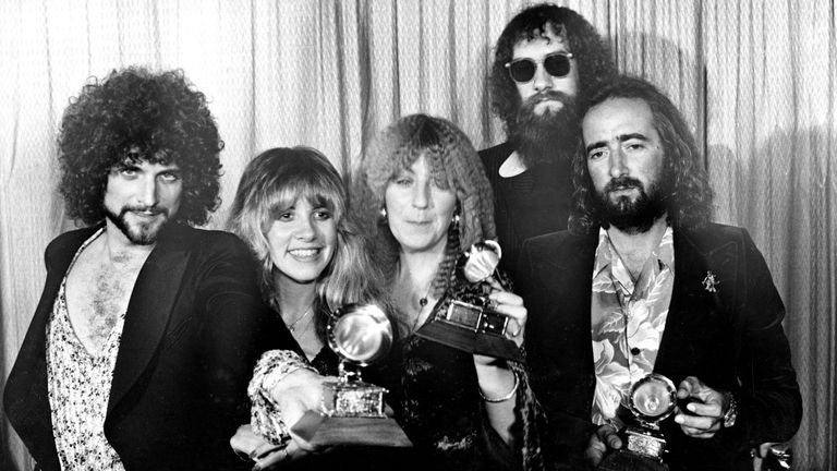 Fleetwood Mac, from left, Lindsey Buckingham, Stevie Nicks, Christine McVie, Mick Fleetwood, wearing sunglasses, and John McVie, pose with their Grammys at the annual Grammy Awards in Los Angeles in 1978