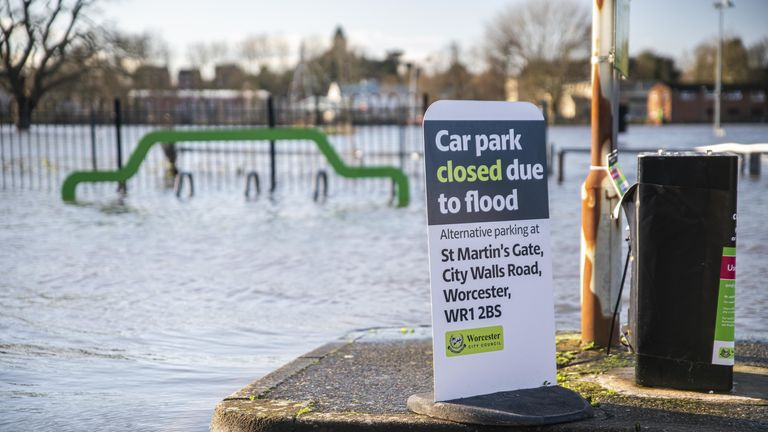 A flooding sign at the flooded Pitchcroft Car Park in Worcester, Worcestershire, where the River Severn continues to rise after several days of heavy rain. Several flood warnings and alerts along the River Severn have been issued.