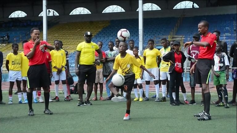 A 12-year-old boy from Nigeria who set a world record for the most consecutive soccer ball touches in one minute while balancing a second ball on his head is planning to take his skills global when he grows up.