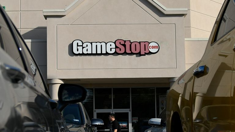 A man walks past a GameStop store in Austin, TX, U.S., March 26, 2018