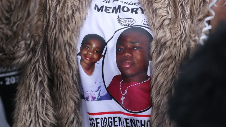 A person wearing a commemorative t-shirt at a gathering to remember George Nkencho in Dublin