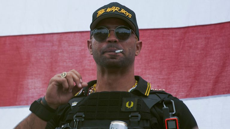 "In this Sept. 26, 2020, file photo, Proud Boys leader Henry ""Enrique"" Tarrio wears a hat that says The War Boys during a rally in Portland, Ore. Police in the nation's capital on Jan. 4, 2021, arrested the leader of the Proud Boys, who is accused of burning a Black Lives Matter banner that was torn down from a historic Black church in downtown Washington in December 2020."