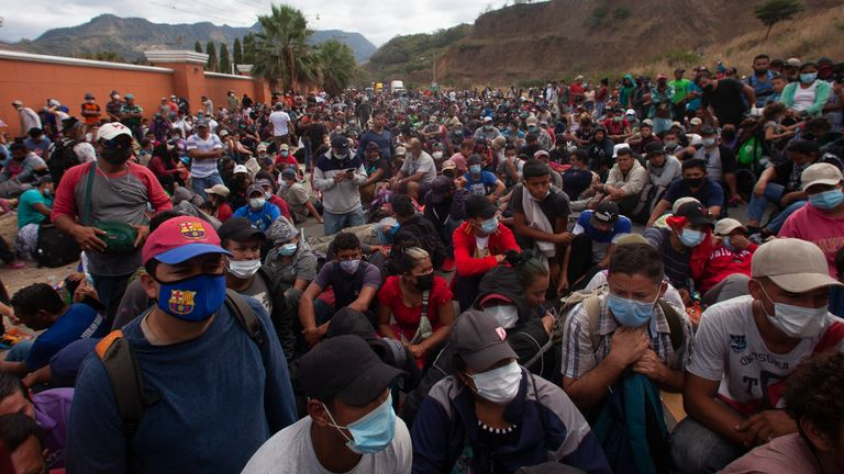 Honduran migrants gather in front of a police roadblock at a highway in Vado Hondo, Guatemala. Pic: AP
