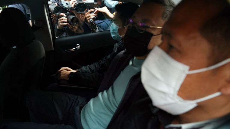 Pro-democracy activist Benny Tai (2nd R) is taken to a police station in Hong Kong,