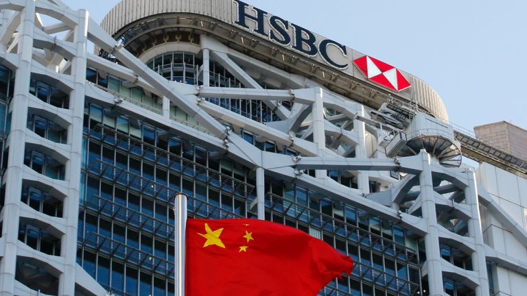 A Chinese national flag flies in front of HSBC headquarters in Hong Kong, China, July 28, 2020