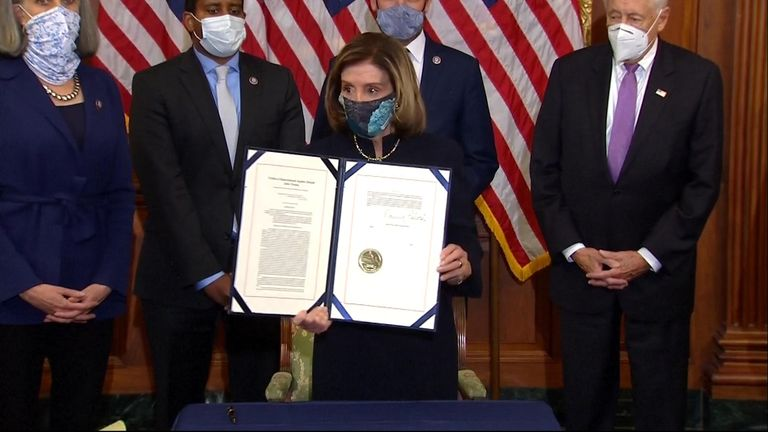 Nancy Pelosi with the signed Articles of Impeachment