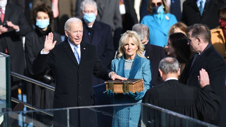 (210120) -- WASHINGTON, Jan. 20, 2021 (Xinhua) -- U.S. President-elect Joe Biden (L, Front) is sworn in as the 46th President of the United States in Washington, D.C., the United States, on Jan. 20, 2021. At an unusual inauguration closed to public due to the still raging coronavirus pandemic, U.S. President-elect Joe Biden was sworn in as the 46th President of the United States on Wednesday at the West Front of the Capitol, which was breached two weeks ago by violent protesters AP pic