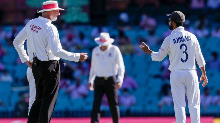 Indian captain Ajinkya Rahane, right, gestures as he speaks with umpire Paul Wilson during play on day three