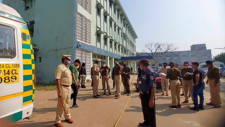 Police officials investigate after the fire broke at a hospital in Bhandara
