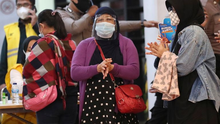 Relatives of passengers arrive at a crisis center set up following a report that a Sriwijaya Air passenger jet has lost contact with air traffic controllers shortly after take off, at Soekarno-Hatta International Airport in Tangerang, Indonesia,Saturday, Jan. 9, 2021. The Boeing 737-500 took off from Jakarta and lost contact with the control tower a few moments later. (AP Photo/Tatan Syuflana)