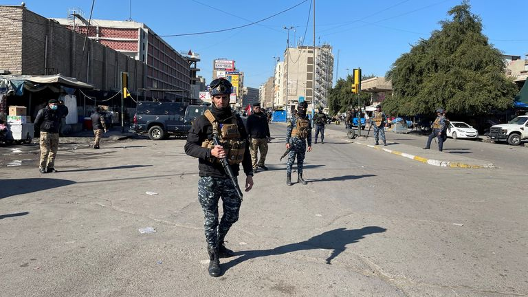 Iraqi security forces keep guard the site of a suicide attack in Baghdad, Iraq January 21, 2021.
