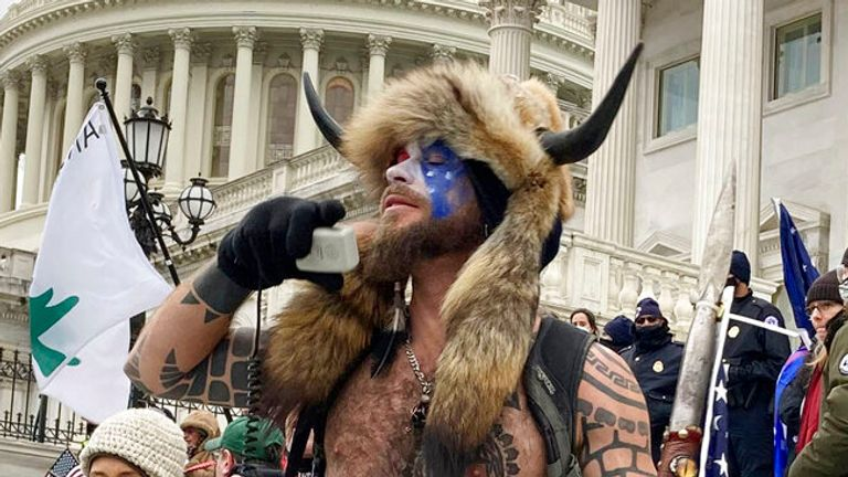 "Photo by: zz/STRF/STAR MAX/IPx 2021 1/7/21 Jake Angeli, a QAnon 'Shaman', was seen storming the Capitol Building yesterday in Washington, D.C.. STAR MAX File Photo: 1/6/21 The United States Capitol Building in Washington, D.C. was breached by thousands of protesters during a ""Stop The Steal"" rally in support of President Donald Trump during the worldwide coronavirus pandemic."