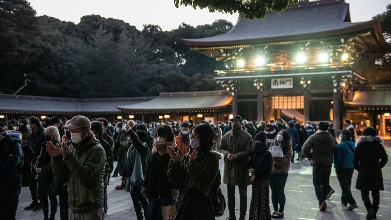 People pray for the New Year at Meiji Shrine in Tokyo, Japan