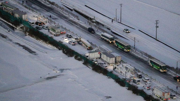 An aerial view shows the site where cars were involved in a series of crashes when a snow storm struck a stretch of highway on the Tohoku Expressway in Osaki, Miyagi prefecture, northern Japan January 19, 2021. Kyodo via REUTERS ATTENTION EDITORS - THIS IMAGE WAS PROVIDED BY A THIRD PARTY. MANDATORY CREDIT. JAPAN OUT. NO COMMERCIAL OR EDITORIAL SALES IN JAPAN.