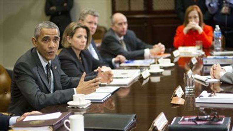 President Barack Obama meets with members of this national security team and cybersecurity advisers in the Roosevelt Room of the White House in Washington,Tuesday, Feb. 9, 2016. Clockwise from the president are, Lisa Monaco, Assistant to the President for Homeland Security and Counterterrorism and Budget Director Shaun Donovan, Counsel to the President Neil Eggleston, Jen Psaki, White House Communications Director, Homeland Security Secretary Jeh Johnson and Attorney General Loretta Lynch