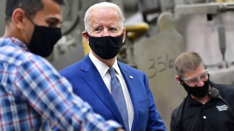 .S. Presidential nominee and former Vice President Joe Biden talks with workers as he tours the Wisconsin Aluminum Foundry before delivering remarks at a campaign event in the factory in Manitowoc, Wisconsin, U.S., September 21, 2020